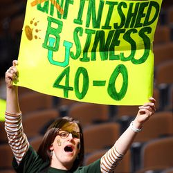 """DENVER, CO - APRIL 03:  A fan of the Baylor Bears holds up a sign which reads """"Finished Business 40-0"""" after they won 80-61 against the Notre Dame Fighting Irish during the National Final game of the 2012 NCAA Division I Women's Basketball Championship at Pepsi Center on April 3, 2012 in Denver, Colorado.  (Photo by Doug Pensinger/Getty Images)"""