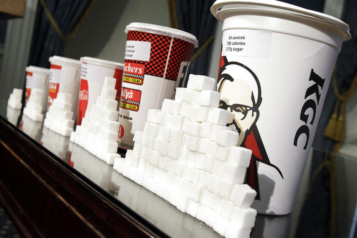 This Thursday, May 31, 2012 file photo shows a display of various size soft drink cups next to stacks of sugar cubes at a news conference at New York's City Hall.
