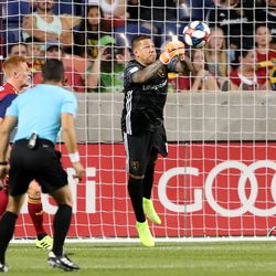 Real Salt Lake goalkeeper Nick Rimando (18) punches the ball away as RSL and the Sounders play at Rio Tinto Stadium in Sandy, Utah, on Wednesday, Aug. 14, 2019.