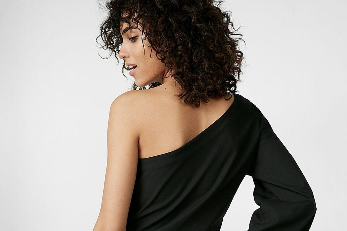 model facing backwards in one shoulder top