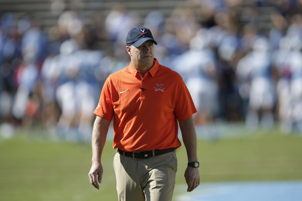Virginia head coach Bronco Mendenhall watches his team warm up prior to game against North Carolina in Chapel Hill, Saturday, Oct. 14, 2017. The Cavaliers defeated to the Tar Heels 20-14 to improve to 5-1 on the season.