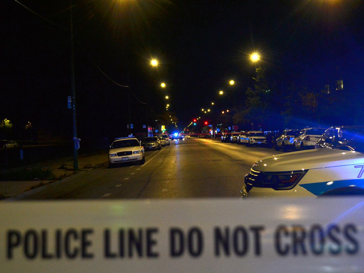 Police investigate a shooting about 11 p.m. Wednesday, October 17, 2018 in the 7800 block of South Halsted Avenue. in Chicago. | Justin Jackson/ Sun-Times
