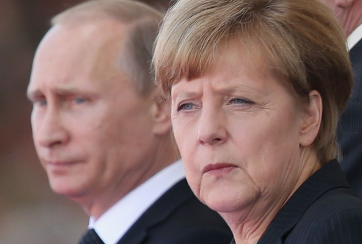 Russian President Vladimir Putin and German Chancellor Angela Merkel at a 2014 commemoration of D-Day in France (Sean Gallup/Getty)