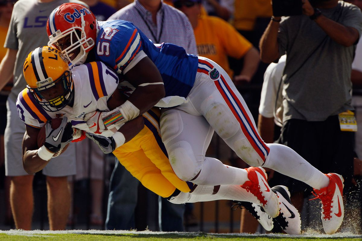 BATON ROUGE, LA - OCTOBER 08:  Russell Shepard #10 of the Louisiana State University Tigers is tackled by Jonathan Bostic #52 of the Florida Gators at Tiger Stadium on October 8, 2011 in Baton Rouge, Louisiana.  (Photo by Chris Graythen/Getty Images)