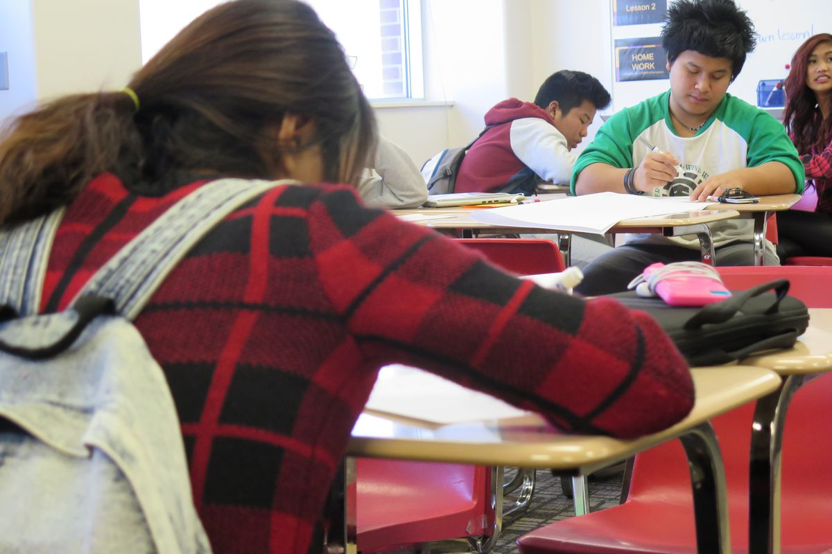 Students in an English-learner class at Southport High School work on an assignment during the last period of the day.