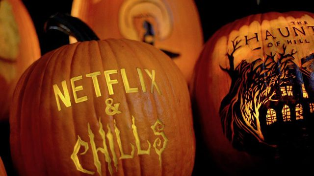 "a pumpkin with the words ""Netflix and Chills"" carved on it"