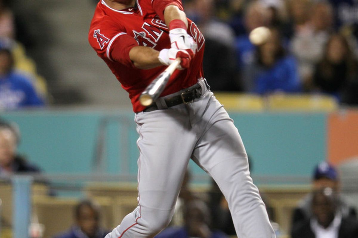 LOS ANGELES, CA - JUNE 11: Mike Trout #27 of the Los Angeles Angels of Anaheim hits an RBI single in the sixth inning against the Los Angeles Dodgers on June 11, 2012 at Dodger Stadium in Los Angeles, California.  (Photo by Stephen Dunn/Getty Images)