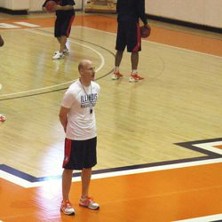 ADVANCE FOR WEEKEND EDITIONS, APRIL 7-8 - In this photo taken April 5, 2012, new Illinois basketball coach John Groce watches his team practice in Champaign, Ill. Groce was hired last month from Ohio University to replace Bruce Weber.