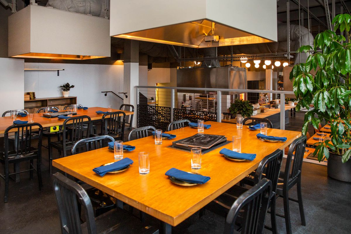 A platform at Meet Korean BBQ with extra seating and vents.
