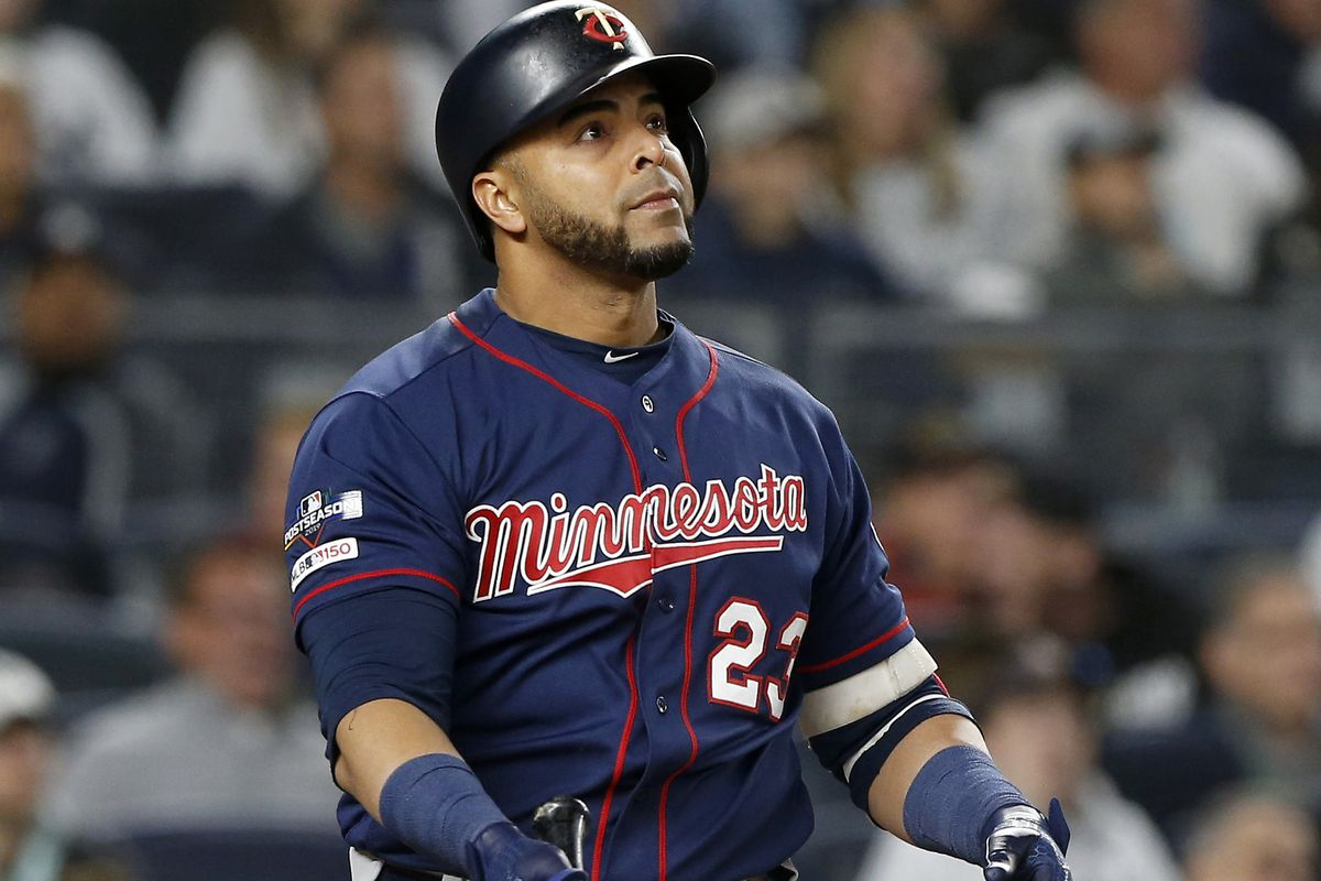 Nelson Cruz #23 of the Minnesota Twins follows through on a third inning home run against the New York Yankees in game one of the American League Division Series at Yankee Stadium on October 04, 2019 in New York City. The Yankees defeated the Twins 10-4.