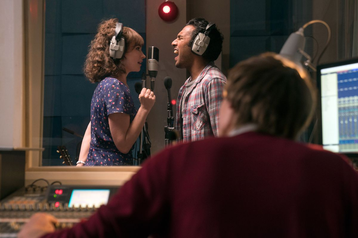 Lily James and Himesh Patel in the recording booth.