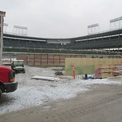 In this photo of left field, there appears to be an opening in the inner bleacher wall next to the red work van. This could have been a location for one of the original outfield doors