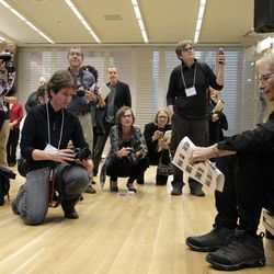 """Annie Leibovitz, right, waits to be introduced for the opening of her exhibition at the Wexner Center for the Arts Friday, Sept. 21, 2012, in Columbus, Ohio. Leibovitz's exhibition features work from her """"Master Set,"""" an authoritative edition of 156 images."""