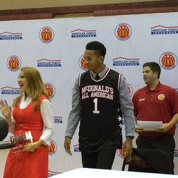 """Lone Peak senior Frank Jackson's mom, Juleen Jackson, accepts a """"Dream"""" award from American Family Insurance, a sponsor of the McDonald's All-American game, for her support of his dream."""