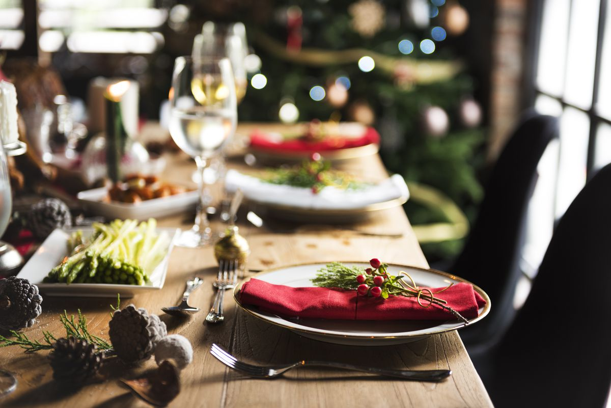Christmas diner table with place setting decorated in holly and ivy
