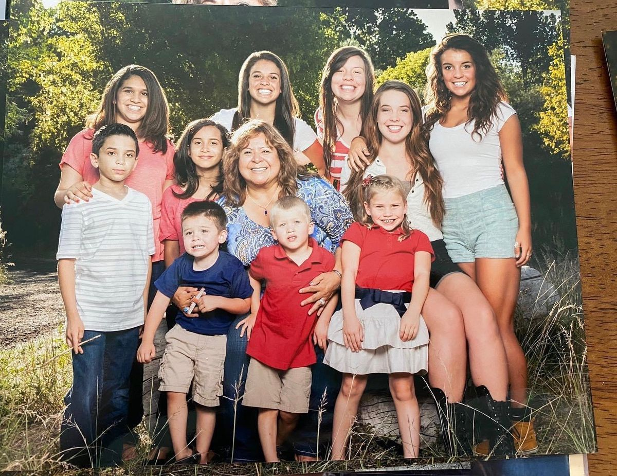 Teresa Vidal is surrounded by her grandchildren. Vidal, 69, of Salt Lake City, died from COVID-19 complications on Aug. 14, 2020, after a two-month battle.