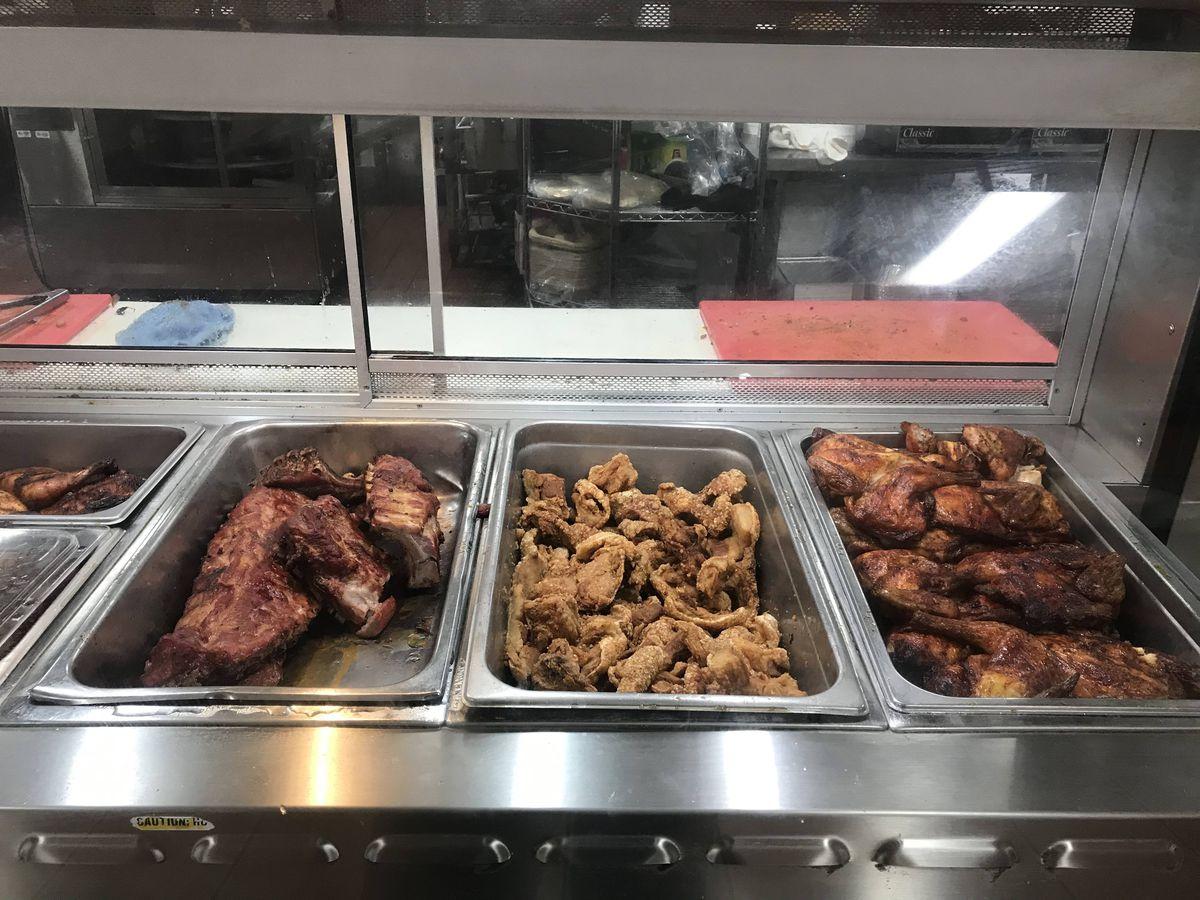 Assorted meats in the hot food display at Mercado del Sol