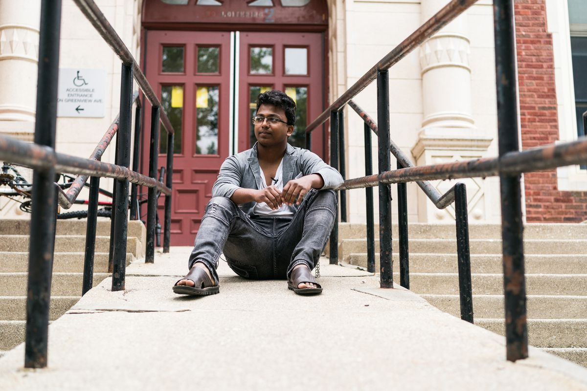At 13, Salamat Khan Bin Jalil Khan fled Myanmar, where the minority Rohingya Muslim community faced violence at the hands of the military. Now 19 and living in Rogers Park, he goes to school and works, seeking an education and a better life for himself and his family. Here, he sits outside Sullivan High School, where he recently finished his sophomore year.