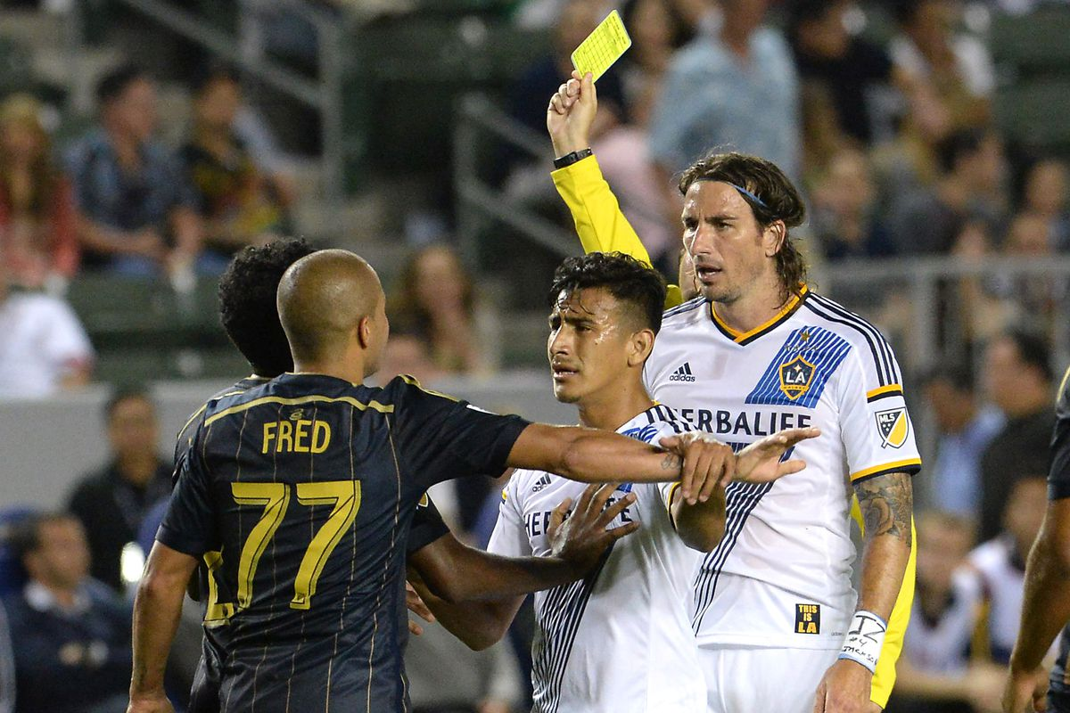 Fred yellow carded for a tough challenge on Robbie Keane.