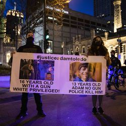 Dozens of protesters march down the Magnificent Mile after the city of Chicago released the videos of 13-year-old Adam Toledo being fatally shot by a Chicago police officer, Thursday evening, April 15, 2021. Toledo was shot to death by an officer on March 29 in an alley west of the 2300 block of South Sawyer Avenue in Little Village on the Southwest Side.