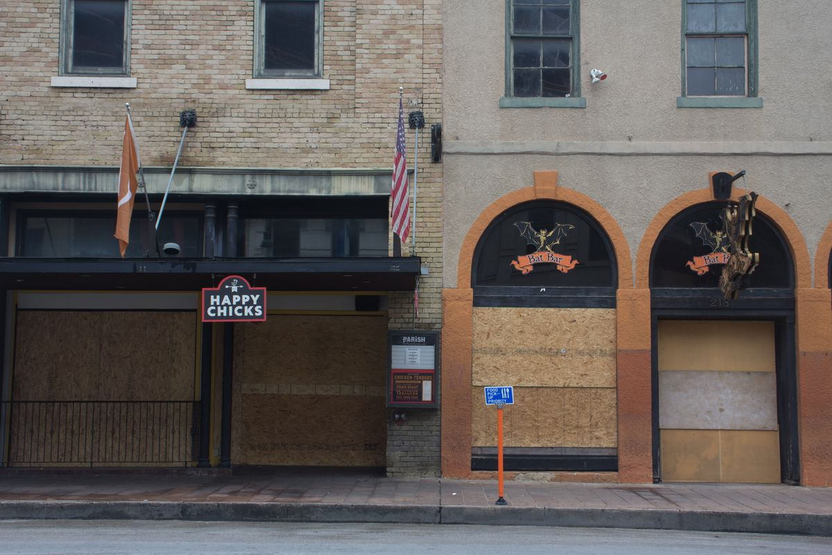 Restaurant Happy Chicks and bar Bat Bar both with boarded-up windows and doors