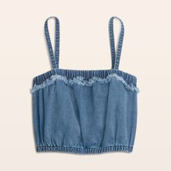 """A denim tank might seem casual for """"going out,"""" but just add high-waisted white trousers and a black choker and you'll get this top's appeal."""