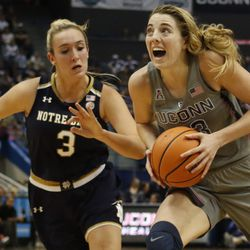 UConn's Katie Lou Samuelson (33) drives past Notre Dame's Marina Mabrey (3) during the Notre Dame Fighting Irish vs UConn Huskies women's college basketball game in the Women's Jimmy V Classic at the XL Center in Hartford, CT on December 3, 2017.
