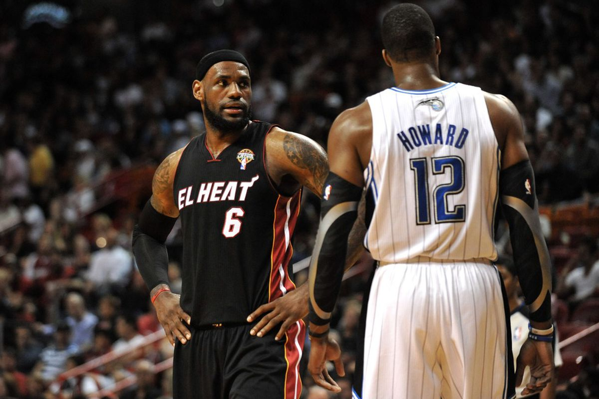 March 18, 2012; Miami, FL, USA; Miami Heat small forward LeBron James (6) talks with Orlando Magic center Dwight Howard (12) during the first half at American Airlines Arena. Heat won 91-81. Mandatory Credit: Steve Mitchell-US PRESSWIRE