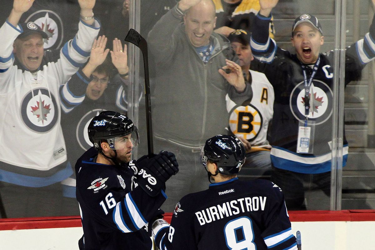 WINNIPEG, CANADA - DECEMBER 6: Andrew Ladd #16 of the Winnipeg Jets celebrates his goal against the Boston Bruins in NHL action at the MTS Centre on December 6, 2011 in Winnipeg, Manitoba, Canada. (Photo by Marianne Helm/Getty Images)