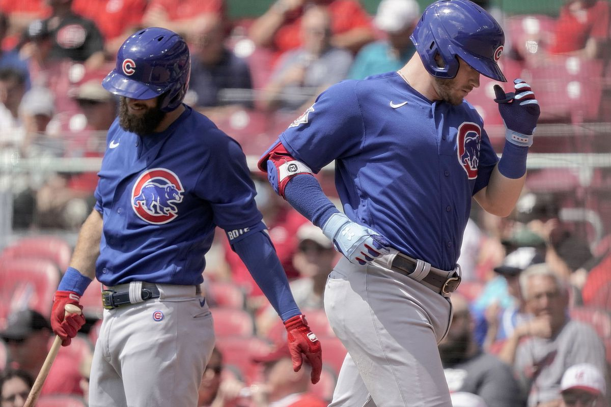 The Cubs Ian Happ, right, jogs past teammate David Bote after hitting a solo home run during the first inning of Wednesday's win over the Reds.