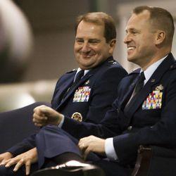 Maj. Gen. Brent Baker Sr., left, jokes with Brig. Gen. Carl Buhler during a change of command ceremony at Hill Aerospace Museum, Monday, Sept. 8, 2014. Buhler assumed command of the Ogden Air Logistics Complex from Baker.