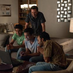 """Jon Hamm stars as sports agent J.B. Bernstein in Walt Disney Pictures Million Dollar Arm."""" He discovers a new way of life with his baseball hopefuls, from left, Suraj Sharma as Rinku, Madhur Mittal as Dinesh and Pitobash as Amit."""