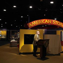 """Marc Pachter, interim director of the Smithsonian National Museum of American History, speaks during a press preview of the new exhibit, """"American Stories,"""" at the museum in Washington, Wednesday, April 11, 2012. The National Museum of American History will open a new exhibit featuring iconic objects from pop culture along with objects dating back to the Pilgrims' arrival in 1620. """"American Stories"""" will be a new chronology of U.S. history from the first encounters of Europeans and Native Americans to the 2008 presidential election."""
