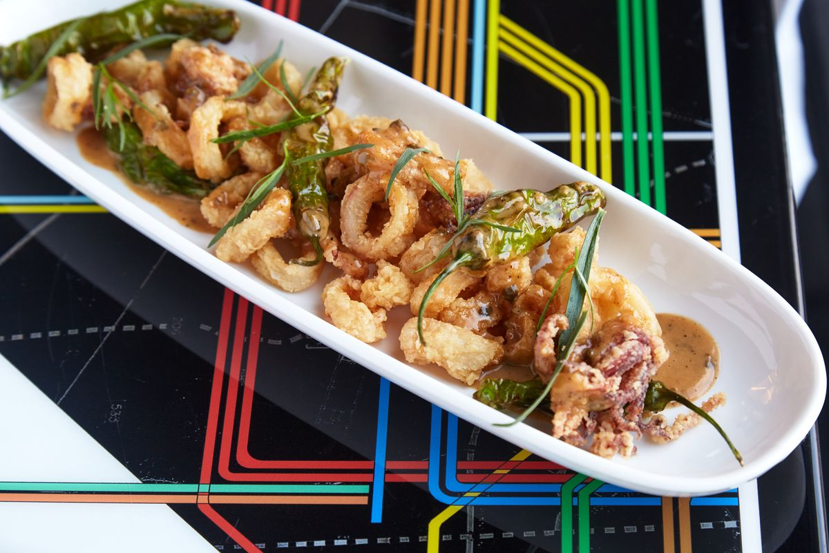 Fried calamari with blistered shishito peppers and caper butter