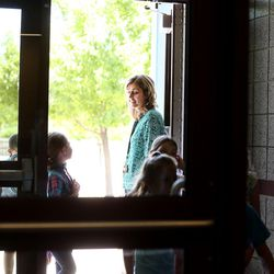 First-grade teacher Nicole Walbeck brings her students in from recess at South Jordan Elementary School on Wednesday, June 8, 2016.