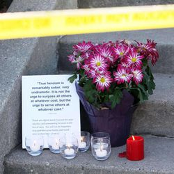 A small memorial has been placed on Jackson Avenue in Ogden, Thursday, Jan. 5, 2012, a short distance from a home where a shooting involving six police officers took place.