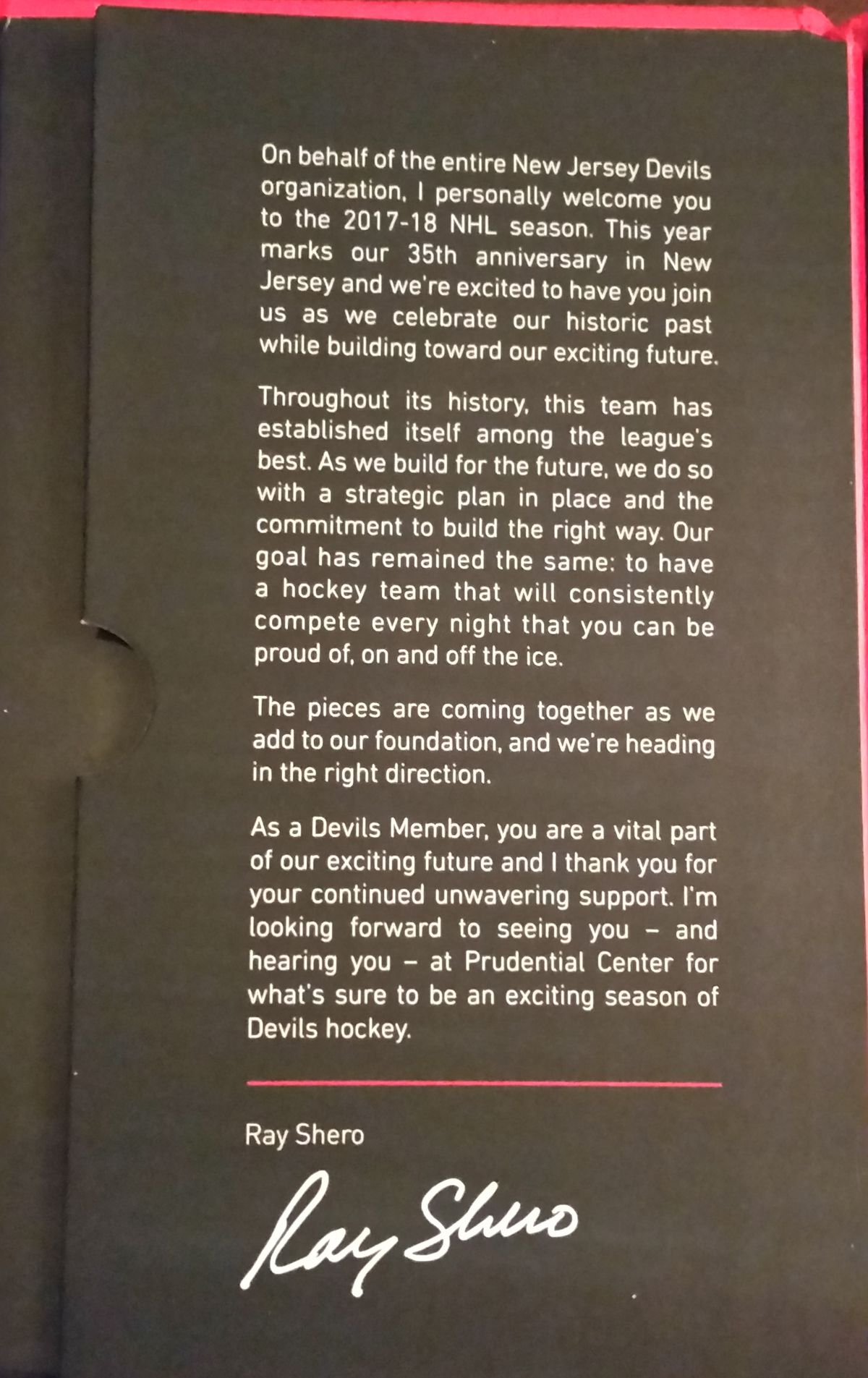 Inside the flap is a message from Devils GM Ray Shero.