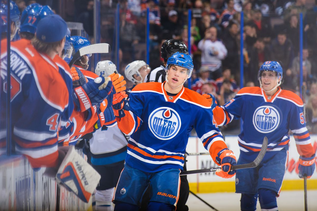 Taylor Hall celebrates after scoring a power play goal