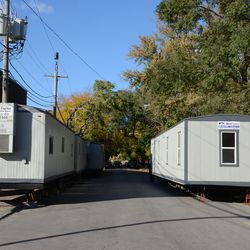 3:45 p.m. Trailers set up on Clifton, north of Waveland -