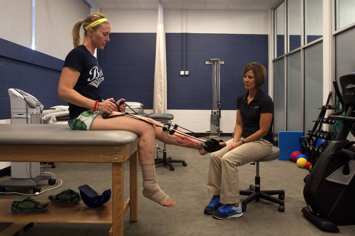 Triathlete Nicole Gross progresses with physical therapy months after the April 15 bombing.