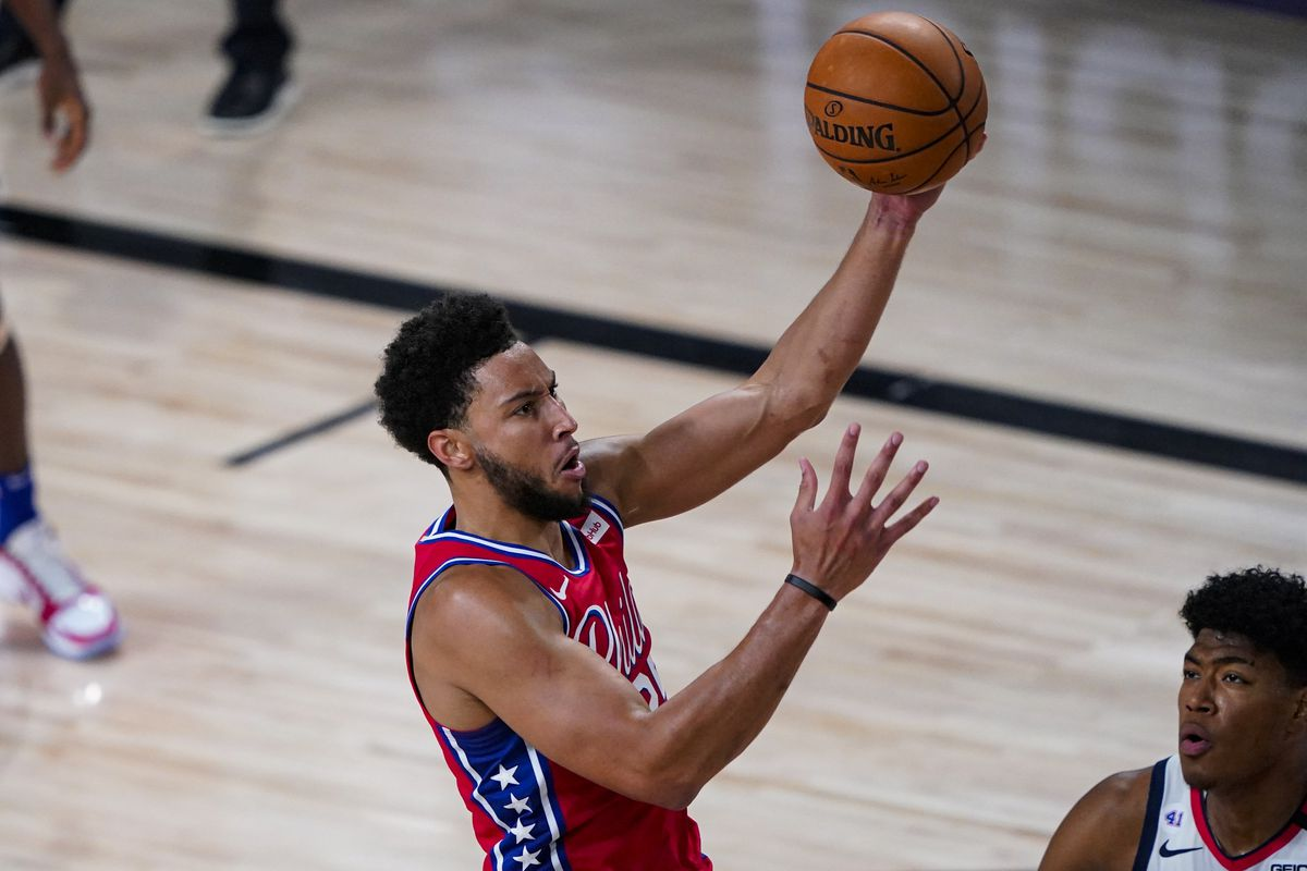 Ben Simmons of the Philadelphia 76ers shoots over Rui Hachimura of the Washington Wizards during the second half of an NBA basketball game at The Arena at ESPN Wide World Of Sports Complex on August 5, 2020 in Lake Buena Vista, Florida.
