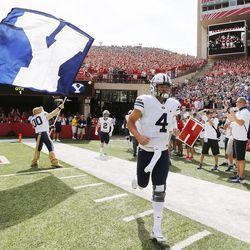 BYU quarterback Taysom Hill (4) runs onto the field against Nebraska in Lincoln, Nebraska, Sunday, Sept. 6, 2015. BYU won 33-28 on a last-second touchdown pass.