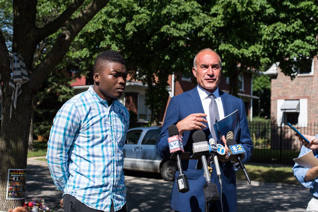 Attorney Michael Oppenheimer (right), with activist Ja'Mal Green, talks about the fatal shooting of Paul O''Neal by Chicago Police officers during a press conference near 74th Street and Merrill Avenue on Aug. 1, 2016. | Max Herman for the Sun-Times