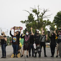 Protesters block traffic as they peacefully march around Kenosha on the fourth day of civil unrest after police shot Jacob Blake, Wednesday night, Aug. 26, 2020.
