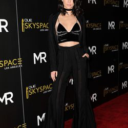 Kendall Jenner wearing an Alice McCall pantsuit with an Are You Am I bra top and Alexander Wang shoes.
