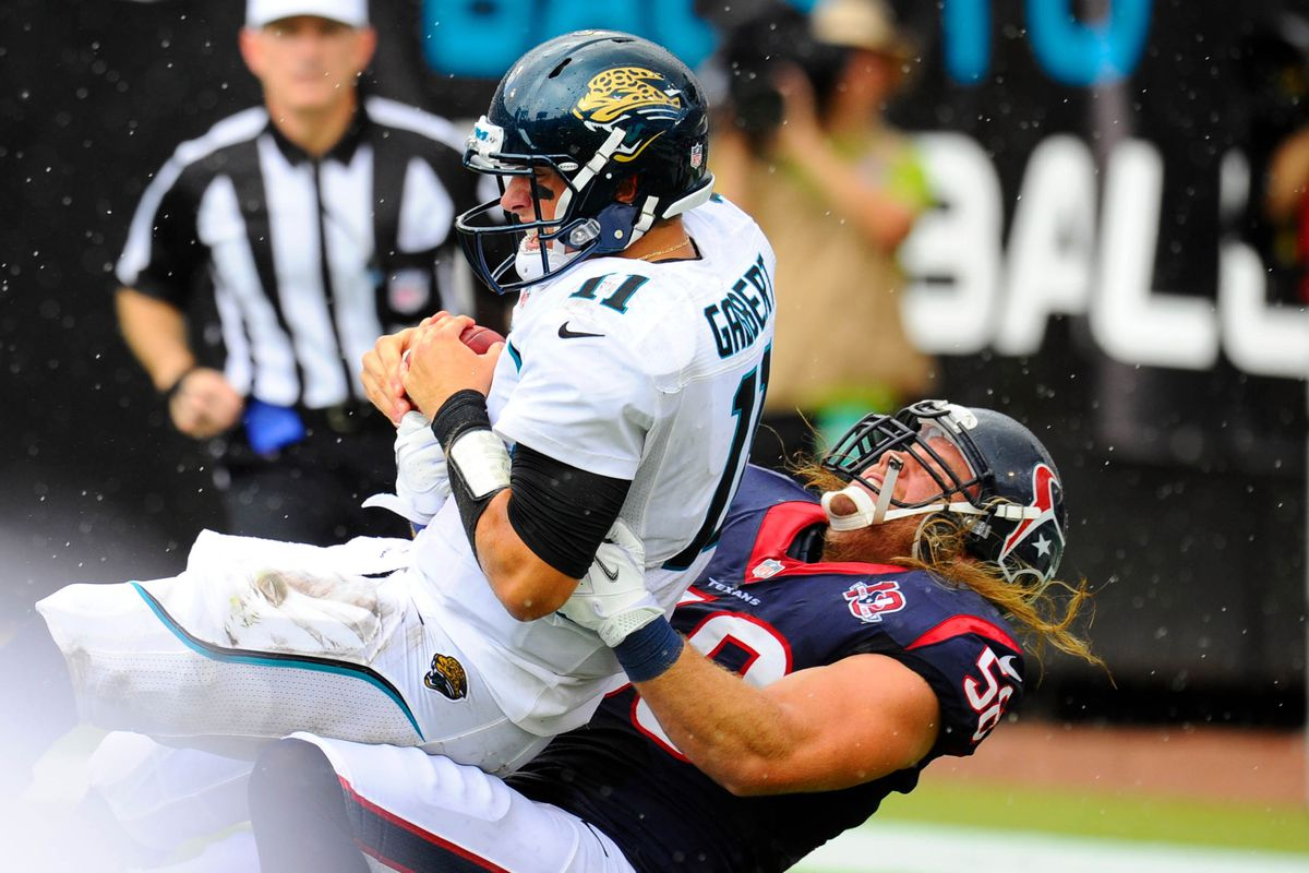 September 16, 2012; Jacksonville, FL, USA; Jacksonville Jaguars quarterback Blaine Gabbert (11) is sacked by Houston Texans outside linebacker Brooks Reed (58) during the second quarter at EverBank Field. Mandatory Credit: Dale Zanine-US PRESSWIRE