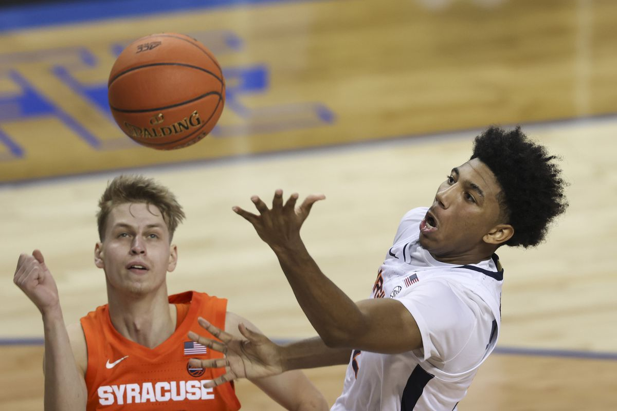 Virginia Cavaliers guard Reece Beekman drives to the basket against Syracuse Orange forward Marek Dolezaj during the first half in the quarterfinal round of the 2021 ACC Tournament
