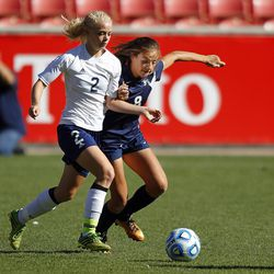 Millard's Anna Camp (2) battles against Maeser's Haylie Chase (8) for possession in the 2A girls high school soccer championships at Rio Tinto Stadium in Sandy, Utah, Saturday, Oct. 24, 2015.