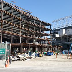 10:55 a.m. View of plaza building and ballpark through open work gate on Clark Street -