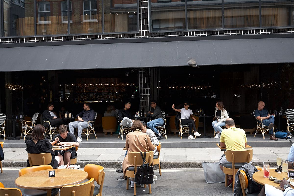 Guests on the pavement outside Chotto Matte on Frith Street in Soho, central London, after lockdown. Soho has been pedestrianised by Westminster council to aid the recovery of the hospitality industry and the wider economy of central London